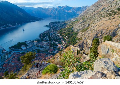 KOTOR, MONTENEGRO - SEPTEMBER 8, 2017: Unknown tourists are at ancient fortress walls above Kotor and Bay of Kotor, Montenegro