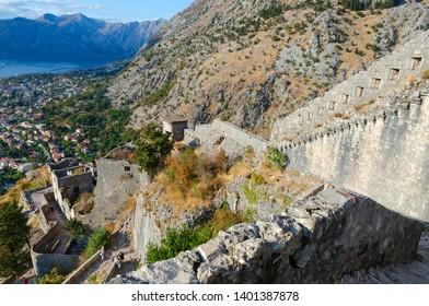 KOTOR, MONTENEGRO - SEPTEMBER 8, 2017: Ruins of ancient fortress walls above Kotor and Bay of Kotor, Montenegro