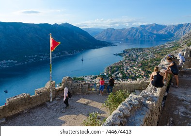 KOTOR, MONTENEGRO - SEPTEMBER 8, 2017: Unknown tourists are on ruins of fortress of St. John (Illyrian Fort) over city of Kotor and Bay of Kotor, Montenegro