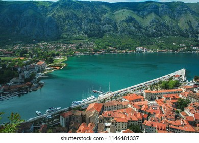 Kotor old town with the main quay seen from above, the mountains of the bay of Kotor (Kotorska Boka) can be seen behind. Kotor is a coastal town in Montenegro.