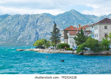 Kotor/Montenegro - 06.18.2017: Winding coastline of Kotor with beautiful buildings and nature on a sunny day