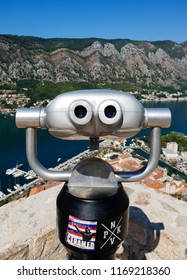Kotor/Montenegro - August 13, 2018: The tower viewer on the top of the Kotor Fortress is directed towards the Bay of Kotor and Kotor old town