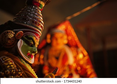 KOTTAYAM, INDIA - MARCH 12, 2019: Kathakali artist doing makeover at backstage for performing traditional dance drama folk art with face painting in temples of Kerala,