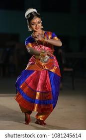 Kottayam, Kerala/ India- April 09, 2018: A beautiful, young Kerala girl performs Bharathanatyam, a popular Indian classical dance form at Madappally Sree Bhagavathi temple during Vishu festival