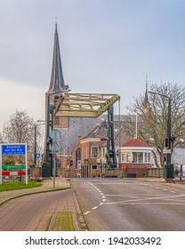 Koudekerk aan den Rijn, The Netherlands - December 6 2020: Bridge over the old Rhine to the village of Koudekerk aan de Rijn in the municipality of Alphen aan den Rijn in the Netherlands