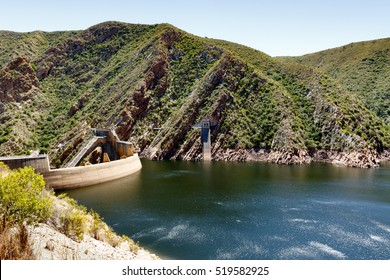 The Kouga Dam is an arch dam on the Kouga River about 21 km west of Patensie in Kouga Local Municipality, South Africa.