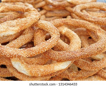 """koulouri"" traditional Greek crispy round bagels with sesame close up"
