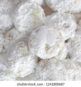 """""""Kourabiedes"""" traditional Greek Christmas cookies covered with powdered sugar, sweet white background"""