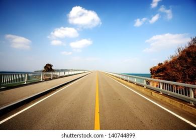 Kouri Bridge in Okinawa, Japan. It is the longest bridge on an open road in Japan, connecting Kouri Island and Yagaji Island at a length of 2,020 meters.