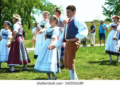 Kourim / Czech Republic - June 9 2019: Czech folklore - Young people in folk clothing, dancing traditional czech dances and singing to celebrate Pentecost (Letnice. Svatodusni svatky)