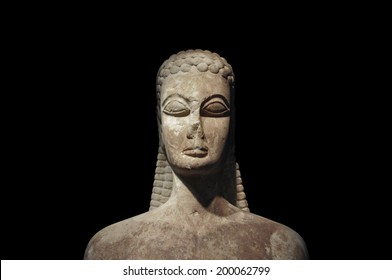 Kouros of the sacred gate ancient statue of young man on black background. Kerameikos museum, Athens Greece.