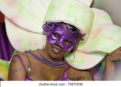 KOUROU, FRENCH GUIANA - FEBRUARY 27: An unidentified parade-goer participates in French Guiana's Annual Carnival February 27, 2011 in Kourou, French Guiana. More than 60 groups participated this year.