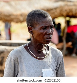 KOUTAMMAKOU, TOGO - JAN 13, 2017: Unidentified Togolese old woman looks ahead in the village. Togo people suffer of poverty due to the bad economy.