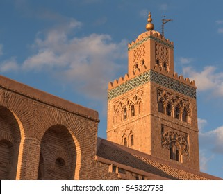 The Koutoubia Mosque or Kutubiyya Mosque, XII Century, the largest mosque in Marrakesh, Morocco. Ornamented with curved windows, a band of ceramic inlay, pointed merlons, and decorative arches.