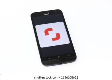 Kouvola, Finland - 23 January 2020: Shutterstock Contributor app logo on the screen of smartphone Asus