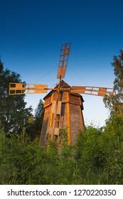 KOUVOLA, FINLAND - JUNE 26, 2009: Old beautiful wooden windmill at sunset in Kotiseutumuseo Elimäki, Kouvola, Finland