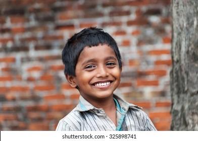 KOVALAM, INDIA - DEC 28, 2014: Portrait of unidentified Indian boy on the street in fishing village. Kovalam. Kerala. India