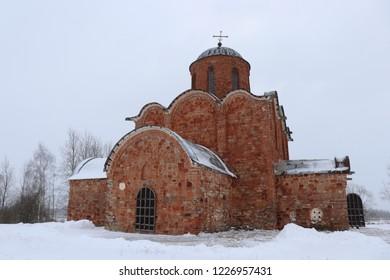 KOVALYOVO, NOVGOROD OBLAST / RUSSIA - DECEMBER 24 2017: The Transfiguration Church in Kovalyovo was built around 1345.
