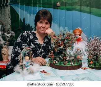Kovel, Volyn / Ukraine - February 17 2009: Woman posing at the table with beads products at home