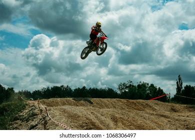 Kovel, Volyn / Ukraine - July 05 2009: Motocross rider jumping high at a jump