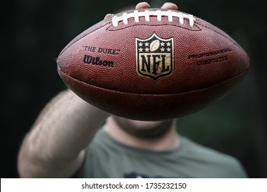 Kovin,Serbia. Date:05.16.2020.  A professional athlete holds a ball for American football.