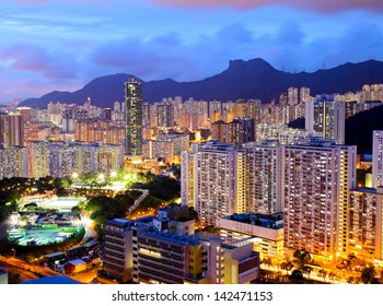 Kowloon area in Hong Kong at night with lion rock
