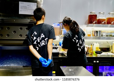 Kowloon, Hong Kong - 15 September 2018:   Workers working in a bubbie tea shop to produce the drinks.