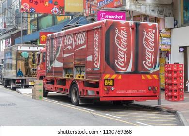 KOWLOON, HONG KONG - APRIL 21, 2017: Big Red Coca Cola Truck Delivery at Mong Kok Street in Kowloon, Hong Kong.