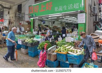 KOWLOON, HONG KONG - APRIL 21, 2017: Fresh Vegetables Store at Local Market Mong Kok in Kowloon, Hong Kong.