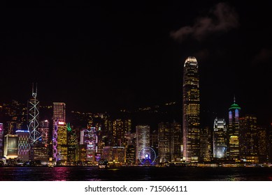 Kowloon , Hong Kong - August 24 , 2017 : Hong Kong Harbor landmark with beautiful colorful building lighting