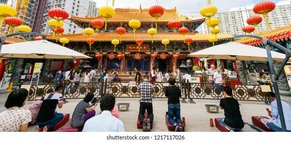"""Kowloon, Hong Kong - Oct 15th 2018: The main altar at the Wong Tai Sin also known as """"The Great Immortal Sin"""" temple. Many tourists around the world visit this every day."""