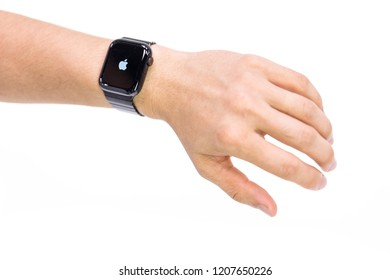 Kowloon, Hong Kong - October 20, 2018:  Apple Watch Series 4 on white background. New smart watches from the company APPLE on the wrist
