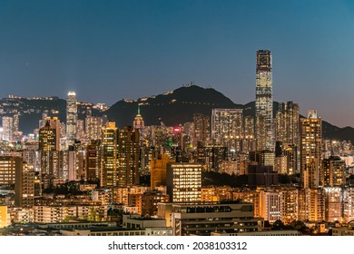 Kowloon, Hong Kong - September 3, 21: A panoramic night view of cityscape of Kowloon and Hong Kong Island from Checkerboard Hill during magic hour.