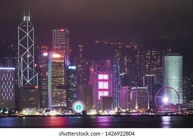 Kowloon Peninsula, Hong Kong - Jan 6, 2019 : The night view of Hong Kong Island from the Kowloon Peninsula