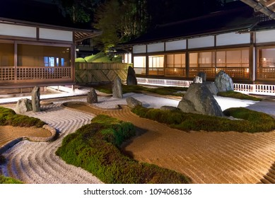 Koyasan, Japan - April 30, 2014: A traditional rock garden inside a Japanese ryokan. A rock garden, often called a zen garden, creates a miniature stylized  landscape to imitate the essence of nature
