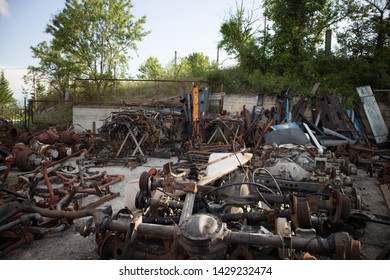 Kozani, Greece - June 2019: A lot of truck axles and other parts, awaiting to be used again or to recycling, in a truck graveyard.