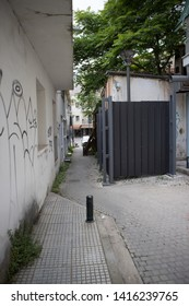 Kozani, Greece - May 2018: A small paved alley, in downtown.