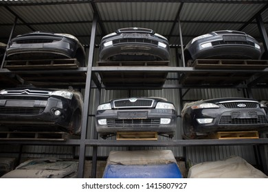 Kozani, Greece - May 2019: A car graveyard, with the front part of half cut vehicles that awaiting dismantling, recycling or sale.