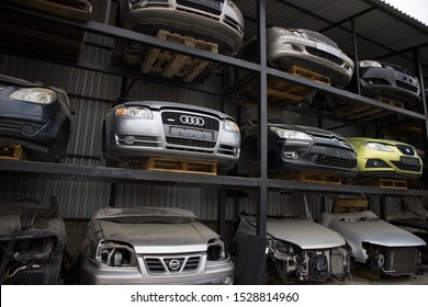 Kozani, Greece - September 2019: A car cemetery, with the front part of half cut vehicles. Awaiting dismantling, recycling or sale.