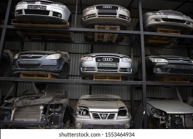 Kozani, Greece - September 2019: The front part of half cut motorcars which awaiting dismantling, recycle or re-sale. At a car graveyard.