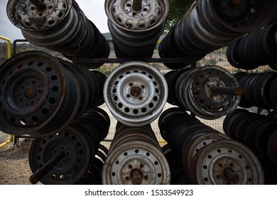Kozani, Greece - September 2019: Rusty rims, awaiting resale or recycle. At a car cemetery.