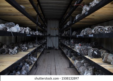 Kozani, Greece - September 2019: A lot of used car parts inside a small warehouse. Awaiting dismantling, recycling or re-sale. At a vehicle graveyard.
