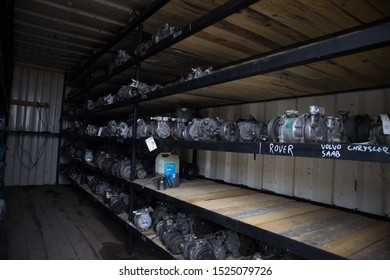 Kozani, Greece - September 2019: A lot of used car motors and other parts inside a small warehouse. Awaiting dismantling, recycling or re-sale. At a vehicle graveyard.