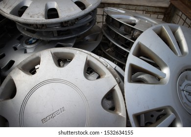Kozani, Greece - September 2019: Used wheel rim covers, inside a metallic trolley. For resale. At a vehicle cemetery.