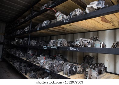 Kozani, Greece - September 2019: Used car motors, inside a small warehouse. Awaiting recycle or resale. At a vehicle graveyard.