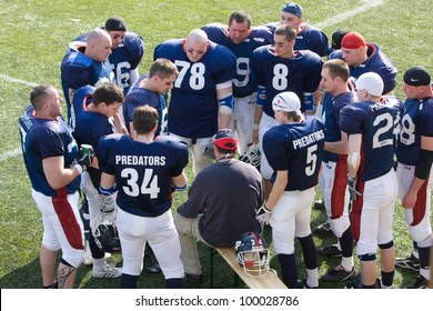 KOZARMISLENY - APRIL 4: Zala Predators (blue) and Pecs Gringos (white) american football teams participate in Hungarian Championship, April 4, 2009 in Kozarmisleny, Hungary.