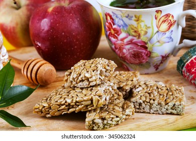 kozinaki sunflower seeds tasty food apples and honey in a still life with a tea party