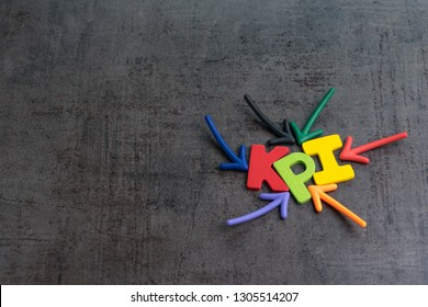 KPI, Key Performance Indicator business target or score to measure success in marketing campaign concept by multiple arrow pointing to colorful alphabet KPI at the center
