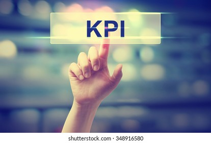 KPI - Key Performance indicator concept with hand pressing a button on blurred abstract background