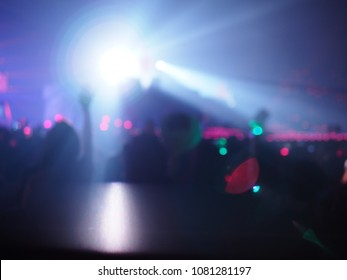 K-Pop music theme or live concert blurred background silhouette of girls putting hands up and holding sign for artist supporting. Enjoy Music and Entertainment Concept. (Space for text)